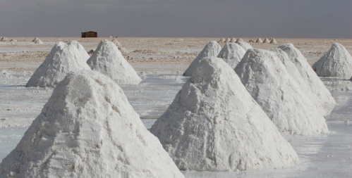Piles of salt mined by local residents sit on the surface of the world's largest salt flats, the Salar de Uyuni